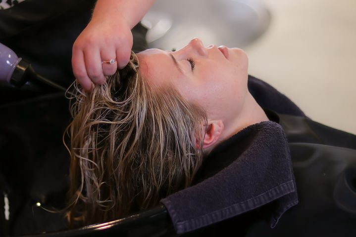 woman getting a Shiseido hair straightening treatment in a salon