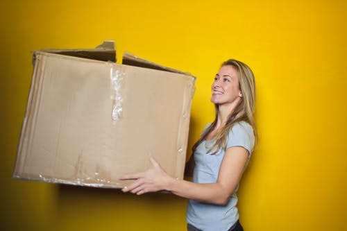 woman carrying a big box